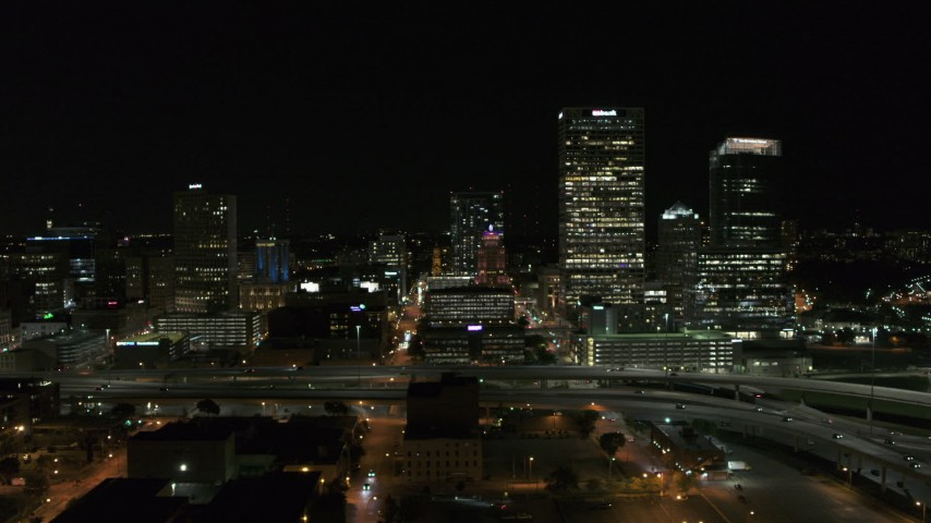 5.7K stock footage aerial video of flying by downtown buildings and skyscrapers at night, Downtown Milwaukee, Wisconsin Aerial Stock Footage | DX0002_151_025