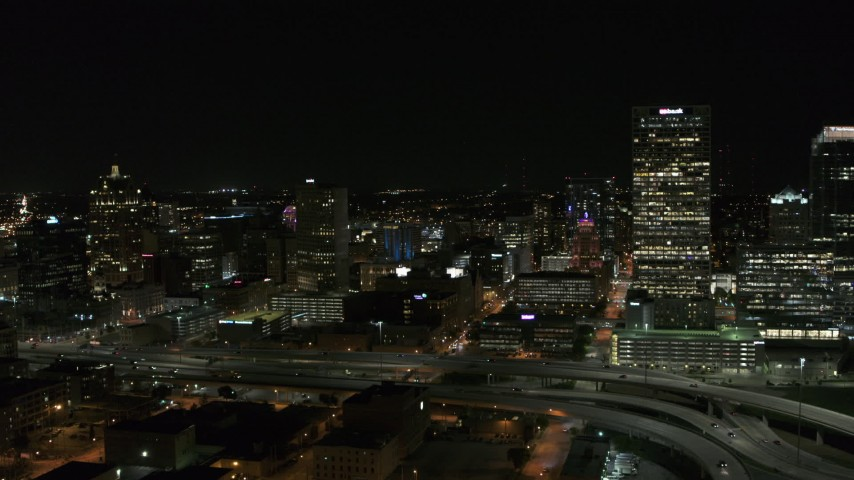 5.7K stock footage aerial video stationary view of downtown buildings and skyscraper at night, Downtown Milwaukee, Wisconsin Aerial Stock Footage | DX0002_151_026