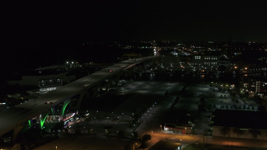 5.7K stock footage aerial video of a view of light traffic on Interstate 794 at night, Downtown Milwaukee, Wisconsin Aerial Stock Footage | DX0002_151_030