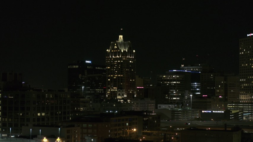 5.7K stock footage aerial video of a skyscraper in Downtown Milwaukee, Wisconsin at night Aerial Stock Footage   DX0002_151_038