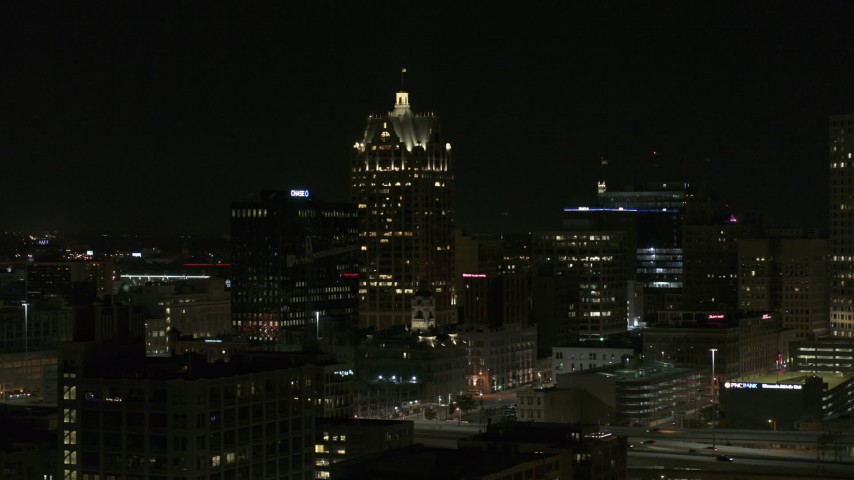 5.7K stock footage aerial video wide orbit of a skyscraper in Downtown Milwaukee, Wisconsin at night Aerial Stock Footage | DX0002_151_039