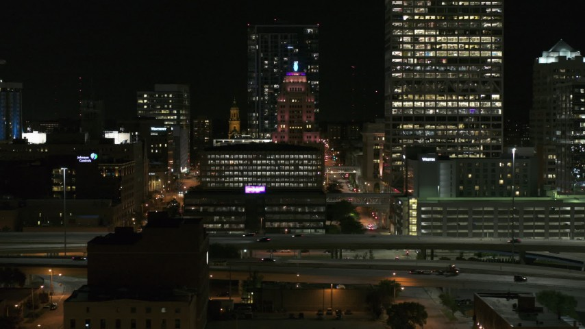 5.7K stock footage aerial video of the Wisconsin Gas Building in Downtown Milwaukee, Wisconsin at night Aerial Stock Footage | DX0002_151_040