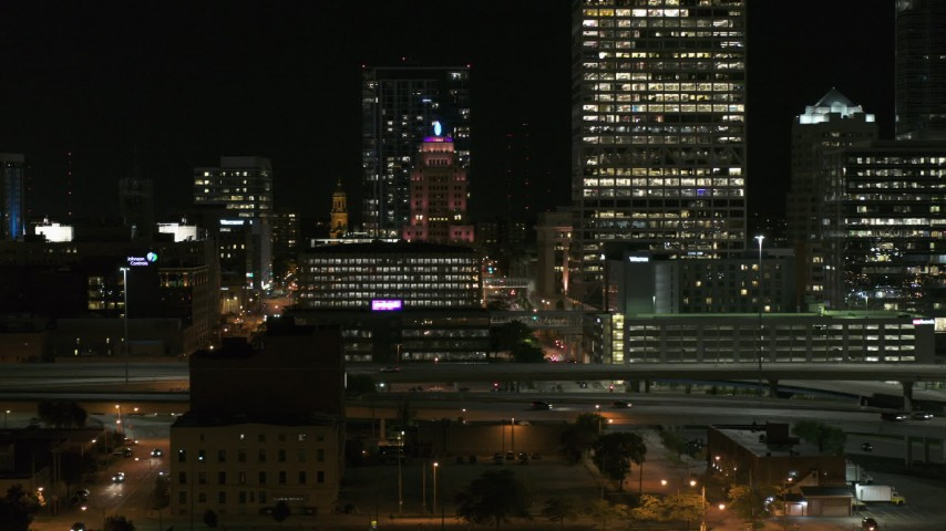 5.7K stock footage aerial video of flying by the Wisconsin Gas Building in Downtown Milwaukee, Wisconsin at night Aerial Stock Footage | DX0002_151_041