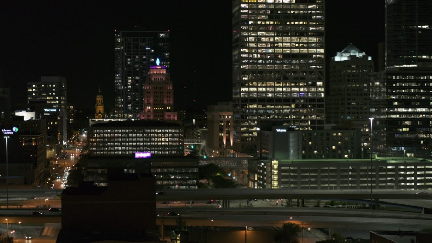 5.7K stock footage aerial video of a view of the Wisconsin Gas Building in Downtown Milwaukee, Wisconsin at night Aerial Stock Footage | DX0002_151_042