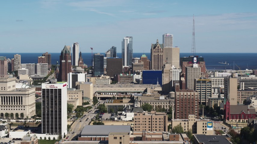 5.7K stock footage aerial video ascend for a wide view of the city's skyline in Downtown Milwaukee, Wisconsin Aerial Stock Footage | DX0002_152_002
