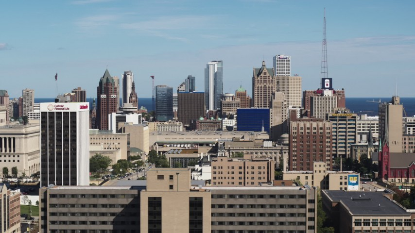 5.7K stock footage aerial video of flying by the city's skyline in Downtown Milwaukee, Wisconsin seen from the university Aerial Stock Footage | DX0002_152_005