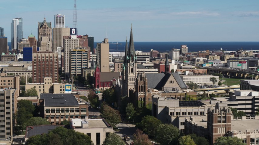 5.7K stock footage aerial video of flying by the Church of the Gesu in Downtown Milwaukee, Wisconsin Aerial Stock Footage | DX0002_152_012