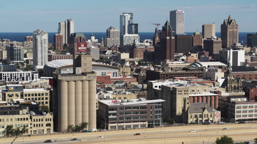 5.7K stock footage aerial video of the city's skyline in Downtown Milwaukee, Wisconsin, seen from industrial buildings Aerial Stock Footage | DX0002_152_013