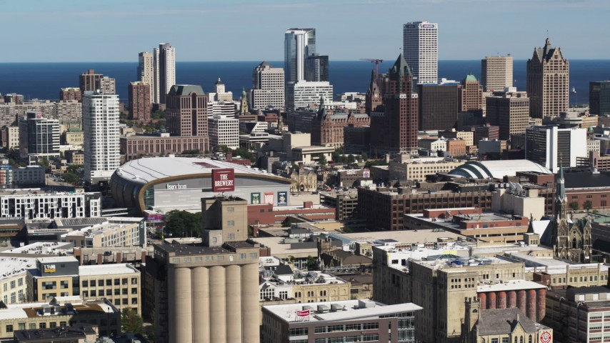 5.7K stock footage aerial video wide view of the city's skyline in Downtown Milwaukee, Wisconsin, seen from industrial buildings Aerial Stock Footage | DX0002_152_014