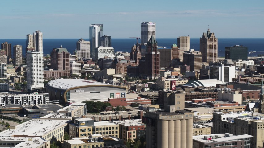 5.7K stock footage aerial video wide view of the city's skyline, arena in Downtown Milwaukee, Wisconsin, seen from industrial buildings Aerial Stock Footage | DX0002_152_015