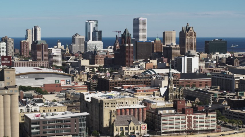 5.7K stock footage aerial video of the city's skyline in Downtown Milwaukee, Wisconsin, descend near industrial buildings Aerial Stock Footage | DX0002_152_016