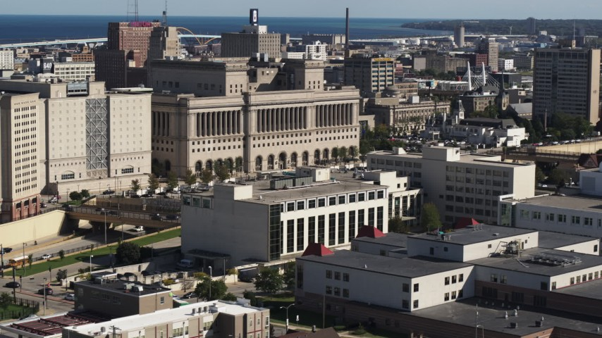 5.7K stock footage aerial video of flying away from a courthouse in Milwaukee, Wisconsin Aerial Stock Footage | DX0002_152_019