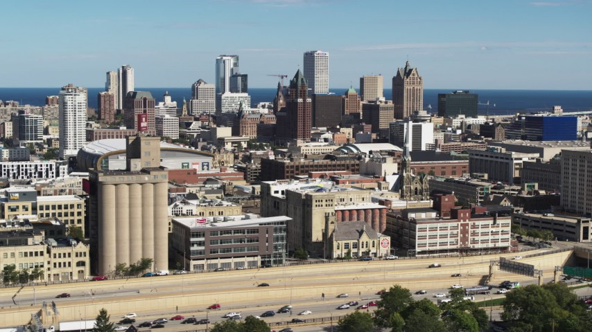 5.7K stock footage aerial video of the city's skyline in Downtown Milwaukee, Wisconsin, seen from I-43 Aerial Stock Footage | DX0002_152_020