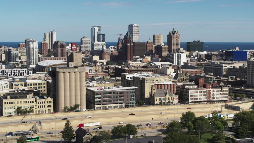 5.7K stock footage aerial video wide view of the city's skyline in Downtown Milwaukee, Wisconsin, seen from I-43 Aerial Stock Footage | DX0002_152_021