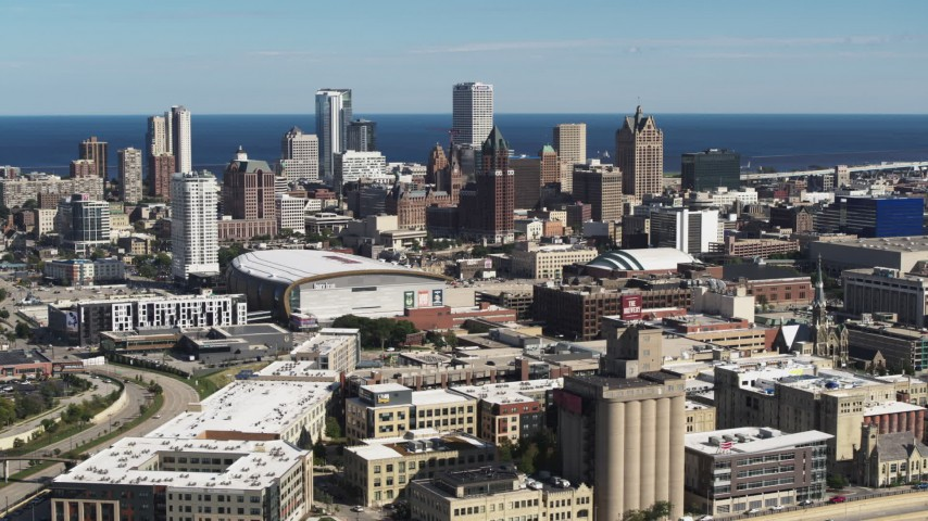 5.7K stock footage aerial video of the city's skyline and arena in Downtown Milwaukee, Wisconsin, seen from I-43 Aerial Stock Footage | DX0002_152_022