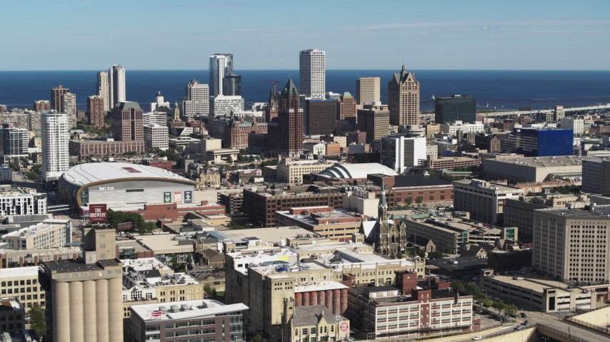 5.7K stock footage aerial video a view of the city's skyline and arena in Downtown Milwaukee, Wisconsin, seen from I-43 freeway Aerial Stock Footage | DX0002_152_023