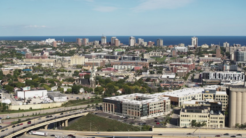 5.7K stock footage aerial video of a wide view of lakeside apartment buildings across the city in Milwaukee, Wisconsin Aerial Stock Footage | DX0002_152_026