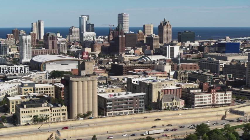 5.7K stock footage aerial video the city's skyline seen from the freeway in Downtown Milwaukee, Wisconsin Aerial Stock Footage   DX0002_152_028