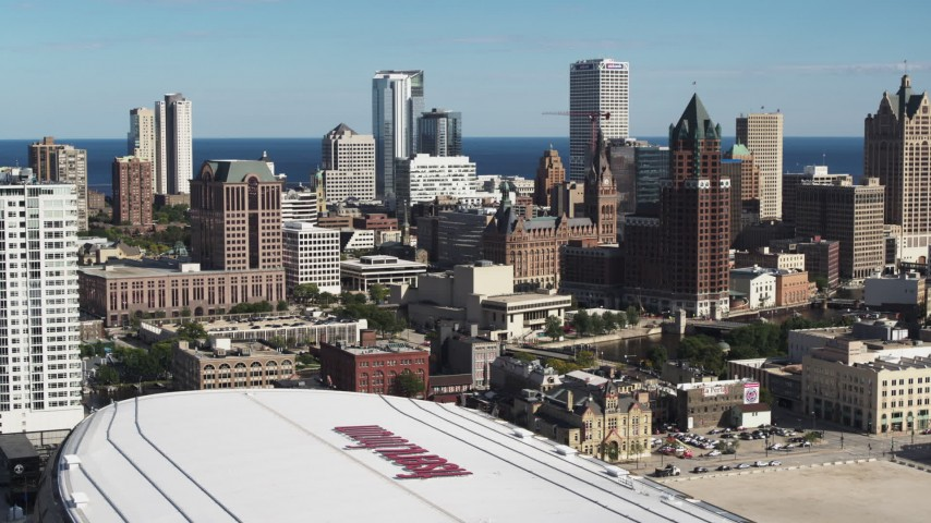 5.7K stock footage aerial video the city's skyline while descending by arena in Downtown Milwaukee, Wisconsin Aerial Stock Footage | DX0002_152_029