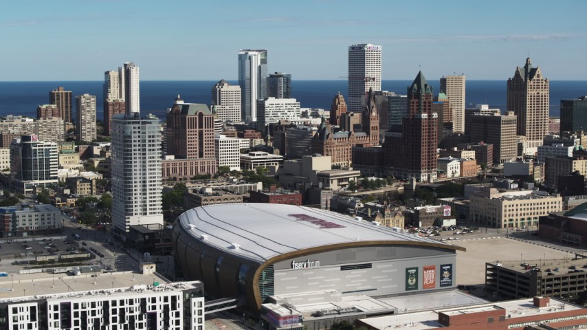 5.7K stock footage aerial video the city's skyline while ascending by arena in Downtown Milwaukee, Wisconsin Aerial Stock Footage | DX0002_152_031