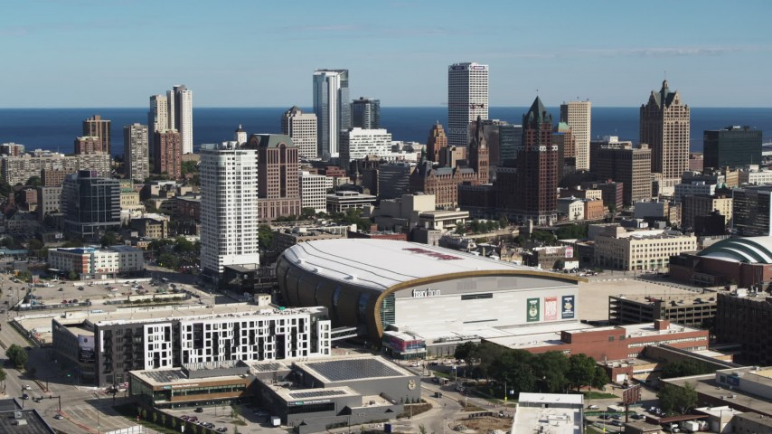 5.7K stock footage aerial video stationary view of the city's skyline and arena in Downtown Milwaukee, Wisconsin Aerial Stock Footage | DX0002_152_032