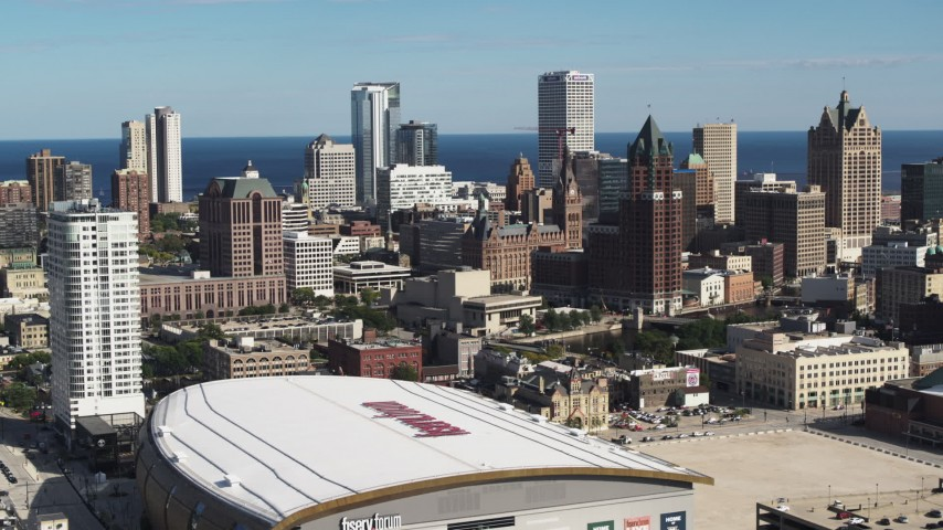 5.7K stock footage aerial video approach the city's skyline and arena in Downtown Milwaukee, Wisconsin Aerial Stock Footage | DX0002_152_033