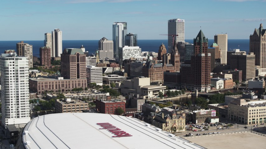 5.7K stock footage aerial video fly away fromthe city's skyline and arena in Downtown Milwaukee, Wisconsin Aerial Stock Footage | DX0002_152_034