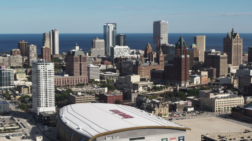 5.7K stock footage aerial video reverse view of the city's skyline and arena in Downtown Milwaukee, Wisconsin Aerial Stock Footage | DX0002_152_035