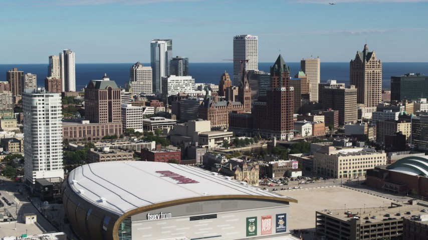 5.7K stock footage aerial video fly toward the city's skyline from the arena in Downtown Milwaukee, Wisconsin Aerial Stock Footage | DX0002_152_036