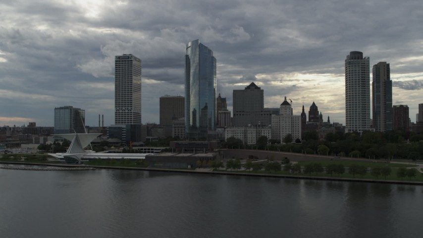 5.7K stock footage aerial video of approaching skyscrapers and the art museum from Lake Michigan in Downtown Milwaukee, Wisconsin Aerial Stock Footage | DX0002_154_004