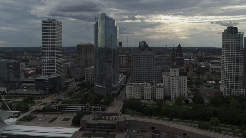 5.7K stock footage aerial video of approaching skyscrapers from the art museum by Lake Michigan in Downtown Milwaukee, Wisconsin Aerial Stock Footage | DX0002_154_005