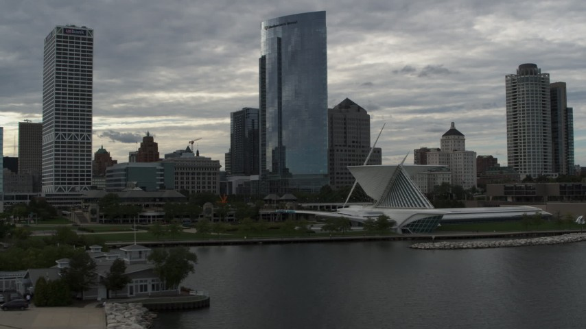 5.7K stock footage aerial video of skyscrapers and the art museum by Lake Michigan in Downtown Milwaukee, Wisconsin Aerial Stock Footage | DX0002_154_007