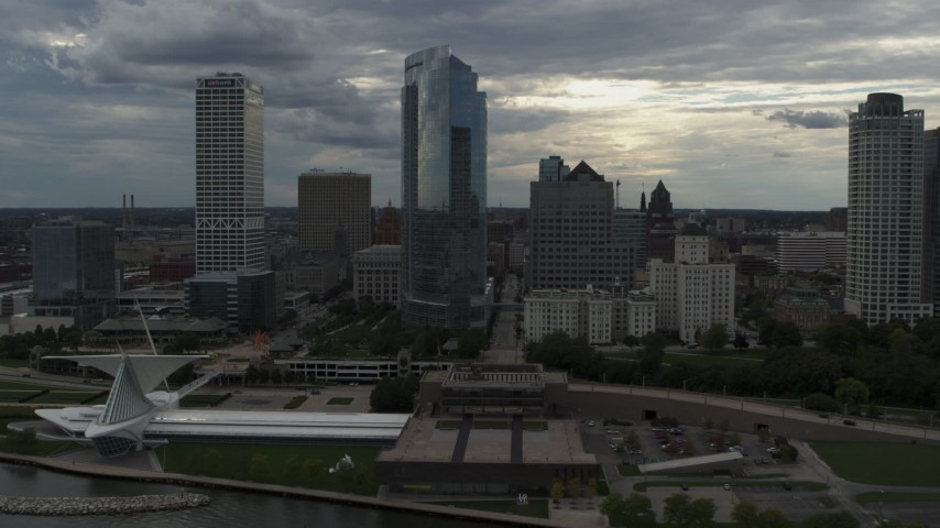 5.7K stock footage aerial video flyby skyscrapers and the art museum by Lake Michigan in Downtown Milwaukee, Wisconsin Aerial Stock Footage | DX0002_154_008