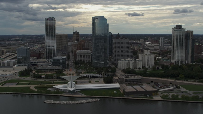 5.7K stock footage aerial video flyby and away from skyscrapers and the art museum by Lake Michigan in Downtown Milwaukee, Wisconsin Aerial Stock Footage | DX0002_154_009