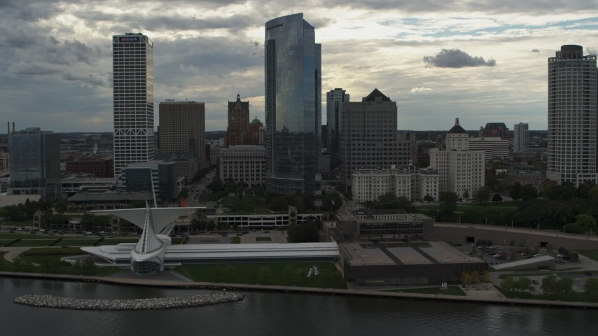 5.7K stock footage aerial video of tall skyscrapers seen while passing the museum, Downtown Milwaukee, Wisconsin Aerial Stock Footage | DX0002_154_024