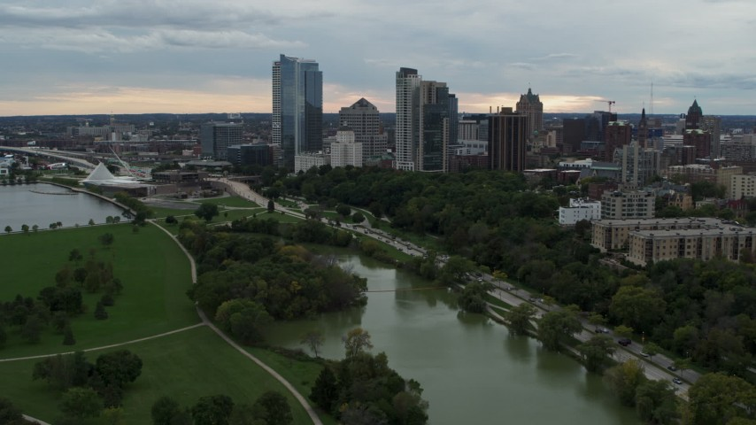 5.7K stock footage aerial video of a reverse view of the skyline from Veterans Park, Downtown Milwaukee, Wisconsin Aerial Stock Footage | DX0002_154_030