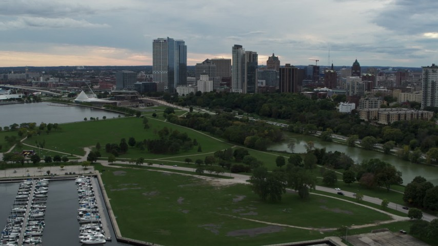 5.7K stock footage aerial video of a view of the skyline from Veterans Park, Downtown Milwaukee, Wisconsin Aerial Stock Footage | DX0002_154_031