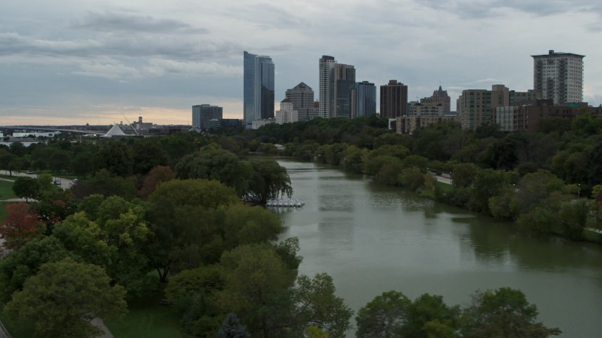 5.7K stock footage aerial video of the city's skyline, seen while flying low over Veterans Park, Downtown Milwaukee, Wisconsin Aerial Stock Footage   DX0002_154_034