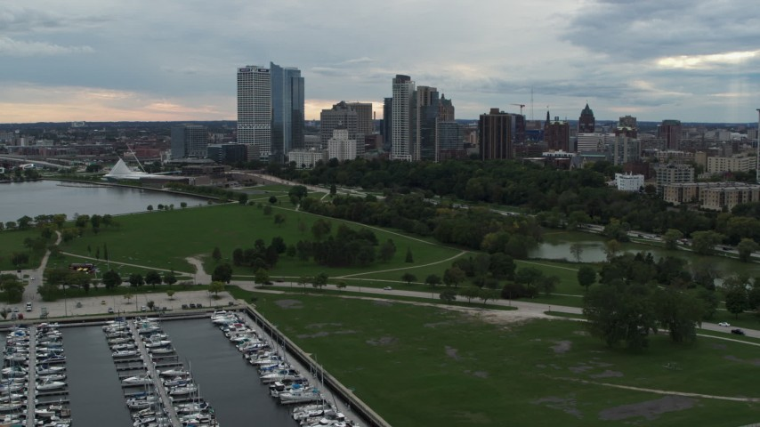 5.7K stock footage aerial video stationary view of the city's skyline, seen from Veterans Park, Downtown Milwaukee, Wisconsin Aerial Stock Footage | DX0002_154_035