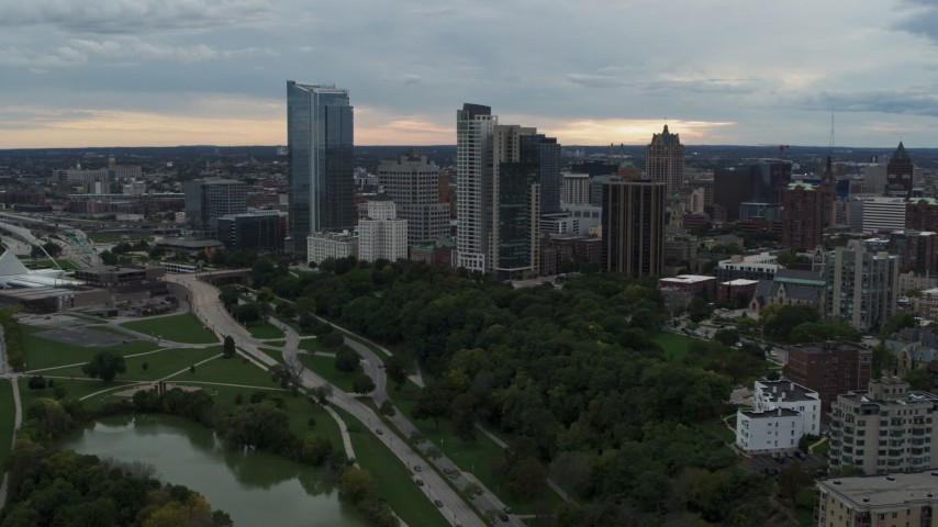 5.7K stock footage aerial video stationary view of the city's skyline from pond at Veterans Park, Downtown Milwaukee, Wisconsin Aerial Stock Footage | DX0002_154_038