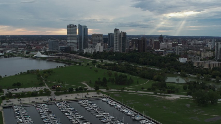 5.7K stock footage aerial video reverse view of Veterans Park and skyline of Downtown Milwaukee, Wisconsin Aerial Stock Footage | DX0002_154_041