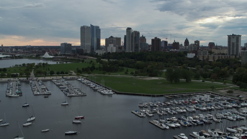 5.7K stock footage aerial video fly over marina toward Veterans Park and skyline of Downtown Milwaukee, Wisconsin Aerial Stock Footage | DX0002_154_044