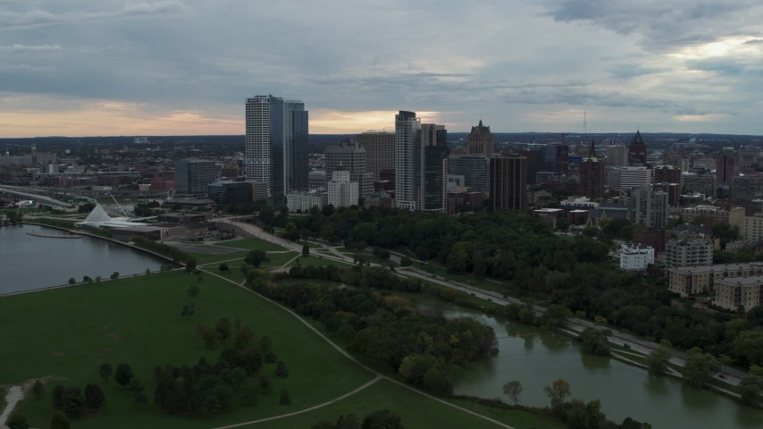 5.7K stock footage aerial video flyby and away from Veterans Park and skyline of Downtown Milwaukee, Wisconsin Aerial Stock Footage   DX0002_154_045