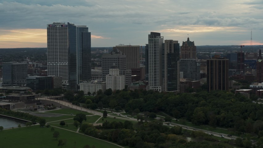 5.7K stock footage aerial video of towering skyscrapers in the city's skyline at sunset, Downtown Milwaukee, Wisconsin Aerial Stock Footage | DX0002_155_002