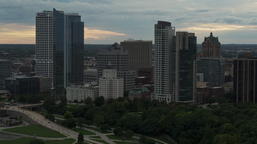 5.7K stock footage aerial video slowly passing the city's skyline at sunset, Downtown Milwaukee, Wisconsin Aerial Stock Footage | DX0002_155_005