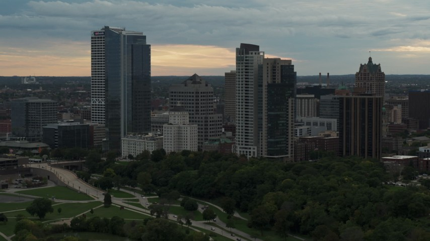 5.7K stock footage aerial video slowly flying away from the city's skyline at sunset, Downtown Milwaukee, Wisconsin Aerial Stock Footage | DX0002_155_006