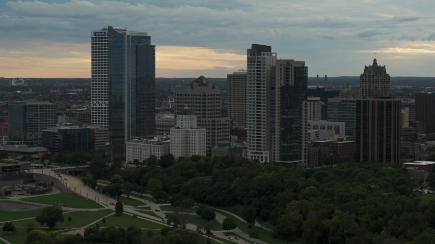 5.7K stock footage aerial video flying past the city's skyline at sunset, Downtown Milwaukee, Wisconsin Aerial Stock Footage | DX0002_155_007