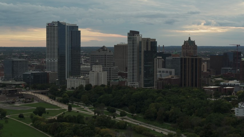 5.7K stock footage aerial video flying by the tall skyscrapers the city's skyline at sunset, Downtown Milwaukee, Wisconsin Aerial Stock Footage | DX0002_155_010