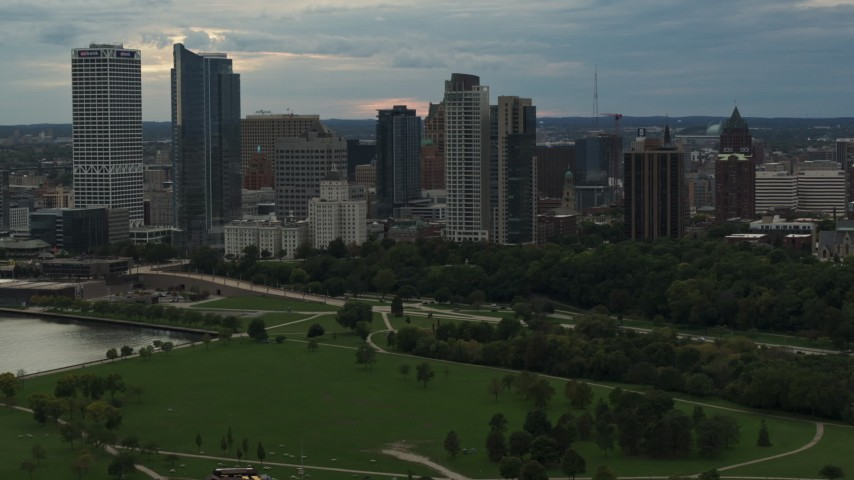 5.7K stock footage aerial video a view of the city's skyline seen from park at sunset, Downtown Milwaukee, Wisconsin Aerial Stock Footage | DX0002_155_011