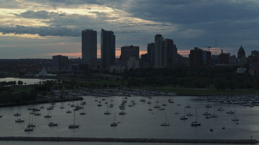5.7K stock footage aerial video the city's skyline seen while flying by marina at sunset, Downtown Milwaukee, Wisconsin Aerial Stock Footage | DX0002_155_017